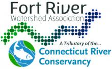 "Grey text says ""Fort River Watershed Association"" with a pixelated river fading from green to blue. Under this it says ""a tributary of the Connecticut River Conservancy"" in blue text with a fish in a circle next to it."